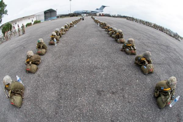 About 70 parachutes and helmets sit on a flight line in preparation for airborne operations during this year's Central Accord exercise in Libreville, Gabon, June 15, 2016. (Photo by Brian Kimball/Defense Department)