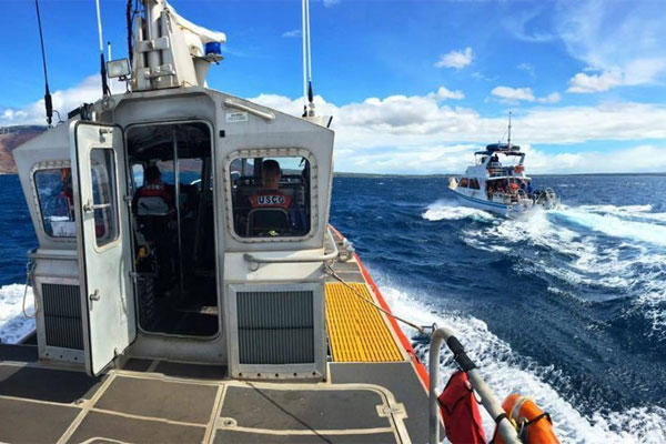 A Coast Guard Station Maui 45-foot Response Boat-Medium crew escorts the commercial passenger vessel Maka Koa back to port five miles south of Maalaea, Maui, Aug. 14, 2016. (U.S. Coast Guard photo by Petty Officer 2nd Class Rob Lester)