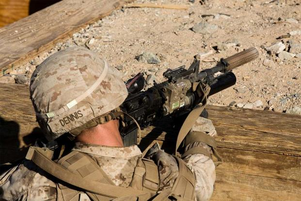A U.S. Marine with Bravo Company, 1st Battalion, 2nd Marine Regiment utilizes a suppressor while providing security on a company attack range in Twentynine Palms, Calif., Oct. 21, 2016. (U.S. Marine Corps/Sarah N. Petrock)
