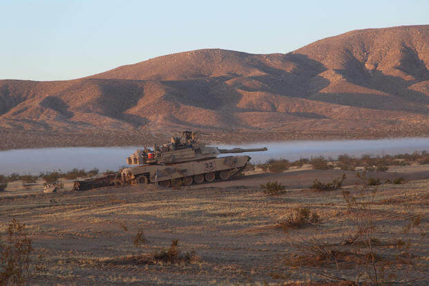 U.S. Army Soldiers assigned to 1st Battalion, 66th Armor Regiment, 3rd Brigade Combat Team, 4th Infantry Division, depart during Decisive Action Rotation 16-09 at the National Training Center in Fort Irwin, Sept. 9, 2016. (U.S. Army/Sgt. Ernesto Gonzalez)