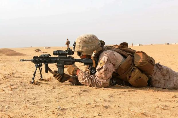 A U.S. Marine fires his M27 Infantry Automatic Rifle while conducting squad attack exercise in Bahrain on Dec. 1, 2016. (Marine Corps photo/Manuel Benavides)
