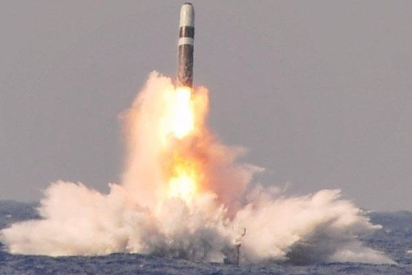 A Trident II D-5 ballistic missile launches from the Ohio-class ballistic missile submarine USS West Virginia (SSBN 736) during a missile test at the Atlantic Missile Range, June 2, 2014. (U.S. Navy photo)