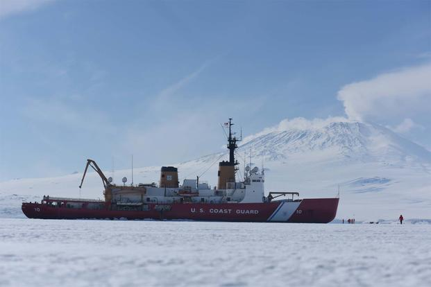 The Coast Guard Cutter Polar Star sits in fast ice in front of Mt. Erebus in McMurdo Sound, Antarctica, Jan. 7, 2016. (U.S. Coast Guard/Petty Officer 2nd Class Grant DeVuyst)