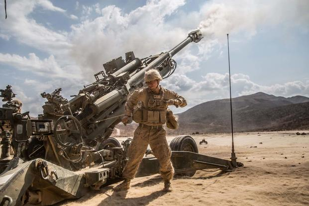 FILE PHOTO -- U.S. Marines from the The 11th MEU fire their M777 Lightweight 155mm Howitzer during Exercise Alligator Dagger, Dec. 18, 2016. (U.S. Marine Corps/Lance Cpl. Zachery C. Laning)