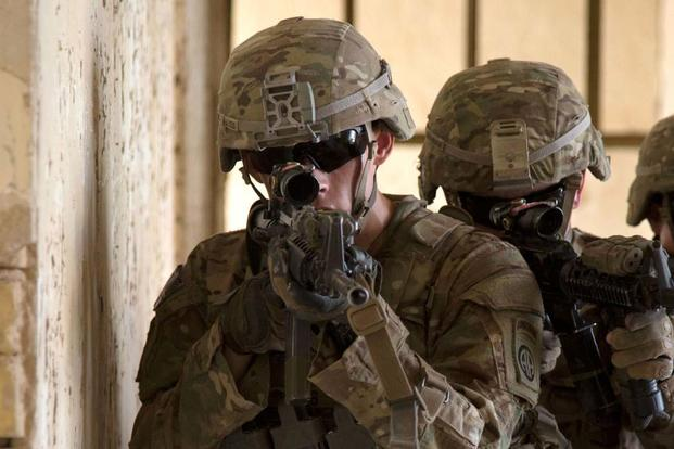 Soldiers wearing the legacy Advanced Combat Helmet, which will be replaced with the lighter ACH Gen II. (Army Photo)
