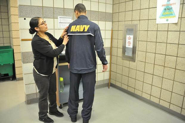Recruits try on their newly issued fitness suits the Navy began rolling out April 24, at Recruit Training Command. (U.S. Navy photo by Susan Krawczyk/Released)