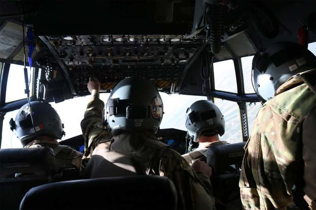 IRAQ- The C-130 crew armors up and keeps watch before landing at the first location in Iraq (Photo: Oriana Pawlyk/Military.com)