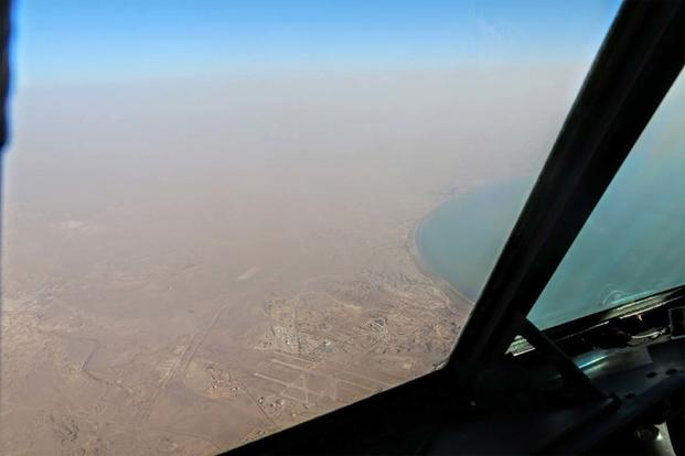A C-130 passing over central Iraq. (Photo: Oriana Pawlyk/Military.com)