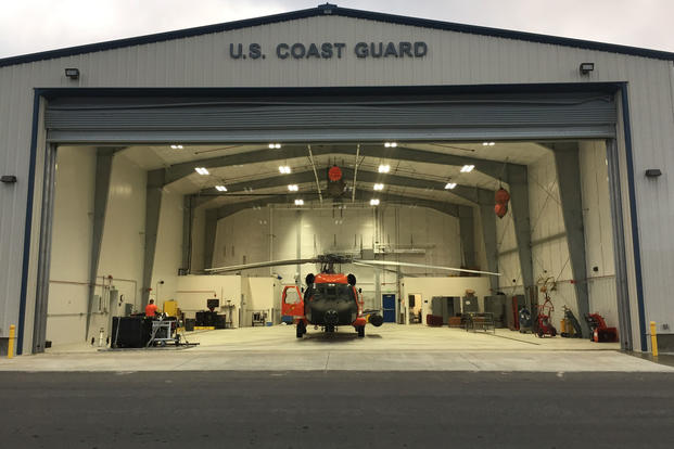 A Coast Guard Air Station Kodiak MH-60 Jayhawk helicopter sits inside a hangar located in Cold Bay, Alaska, Oct. 5, 2017. (U.S. Coast Guard photo/Lt. Megan Peters)