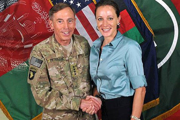 This July 13, 2011, photo shows the former commander of International Security Assistance Force and U.S. Forces-Afghanistan Gen. Davis Petraeus, left, shaking hands with Paula Broadwell.