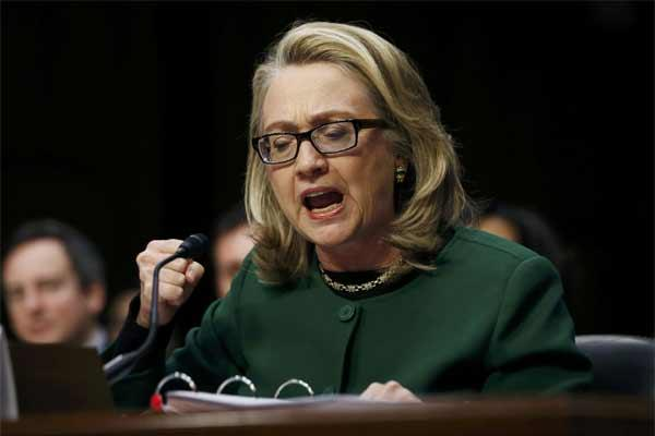 Secretary of State Hillary Rodham Clinton pounds her fist as she testifies on Capitol Hill in Washington, Wednesday, Jan. 23, 2013, before the Senate Foreign Relations Committee hearing on the September attack on the U.S. diplomatic mission in Benghazi.