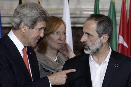U.S. Secretary of State John Kerry, left, talks to Syrian opposition coalition leader Mouaz al-Khatib, during an international conference on Syria at Villa Madama, Rome,Thursday, Feb. 28, 2013.