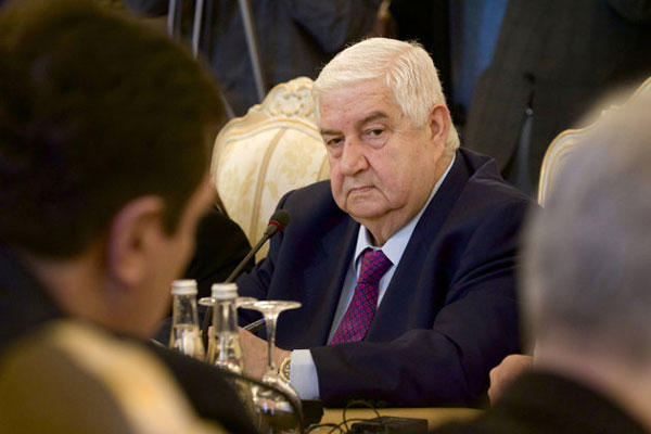 Syrian Foreign Minister Walid al-Moallem attends a meeting with his Russian counterpart Sergey Lavrov, unseen, in Moscow on Monday, Feb. 25, 2013.