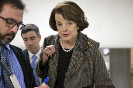 Senate Intelligence Committee Chairman Dianne Feinstein, D-Calif., is interviewed by reporters.