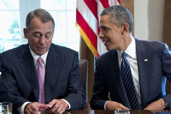 President Barack Obama talks with House Speaker John Boehner of Ohio, prior to speaking to media, in the Cabinet Room of the White House in Washington, Tuesday, Sept. 3, 2013,