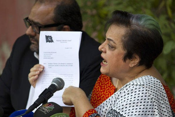 Shireen Mazari, information secretary of the Pakistan Tehreek-e-Insaf party, shows a document during a news conference in Islamabad, Pakistan, Wednesday, Nov. 27, 2013.