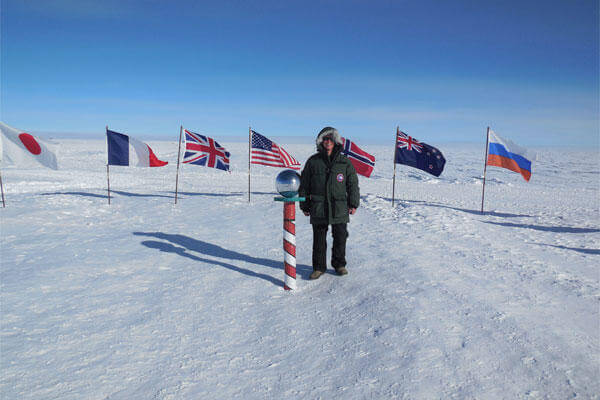 Cadet 1st Class Glen Hanson stands at the South Pole in December. The meteorology major spent a week observing climate, satellite, biological and astronomical research at McMurdo Station, Antarctica.