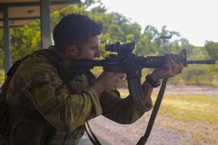Capt. Christian Difabio, commanding officer of Logistics Company, 5th Battalion Royal Australian Regiment, fires the M4 Carbine aboard Robertson Barracks, April 15, 2014.