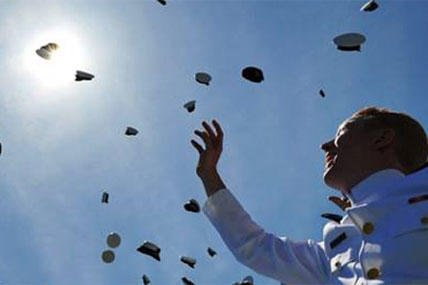Cadets throw their covers into the air as they officialy become ensigns during the 133rd commencement exercises at the U.S. Coast Guard Academy in New London, Conn., May 21, 2014.