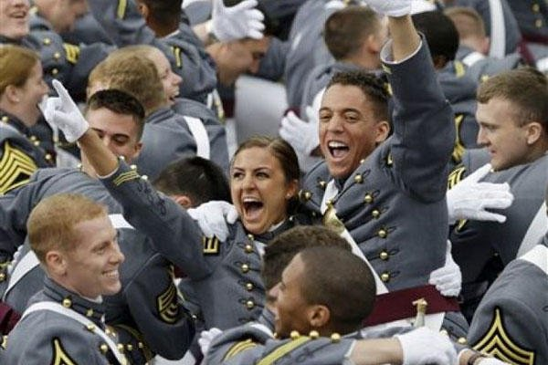 Graduating cadets celebrate at the end of a graduation and commissioning ceremony at the U.S. Military Academy, Wednesday, May 28, 2014, in West Point, N.Y.
