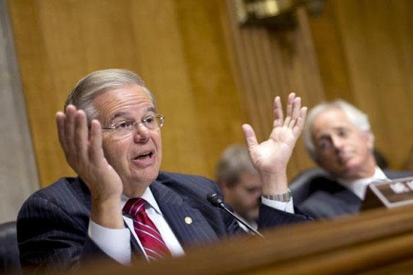 Chairman of the Senate Foreign Relations Committee, Sen. Robert Menendez, D-NJ., left, gestures during a hearing on Capitol Hill, Wednesday, July 9, 2014, (AP Photo/Pablo Martinez Monsivais)