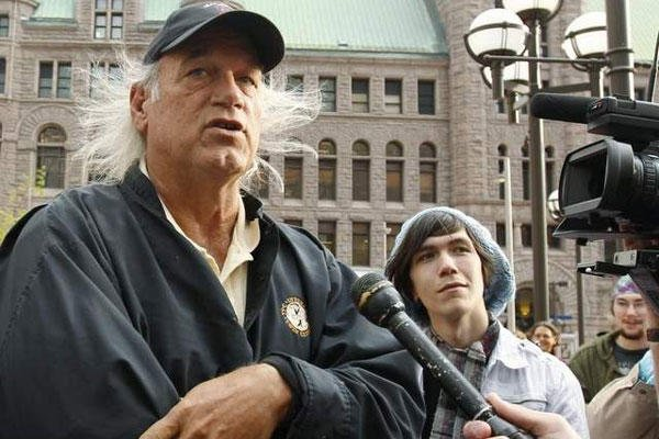 Former Minnesota Gov. Jesse Ventura, left, talks to the media in Minneapolis in this Oct. 7, 2011 file photo. (Genevieve Ross / AP)