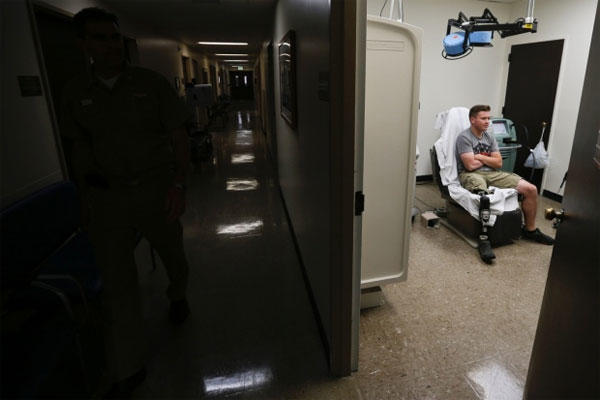 In this photo taken on May 23, 2014, retired Marine Gunnery Sgt. Brian Meyer awaits a doctor at the Naval Medical Center in San Diego. (AP photo)