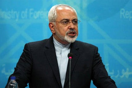 In this Sunday, Aug. 24, 2014 file photo, Iranian Foreign Minister Mohammad Javad Zarif speaks during a joint news conference with his Iraqi counterpart in Baghdad. On Wednesday, Sept. 17, 2014. (AP Photo/Ahmed Saad, Pool)