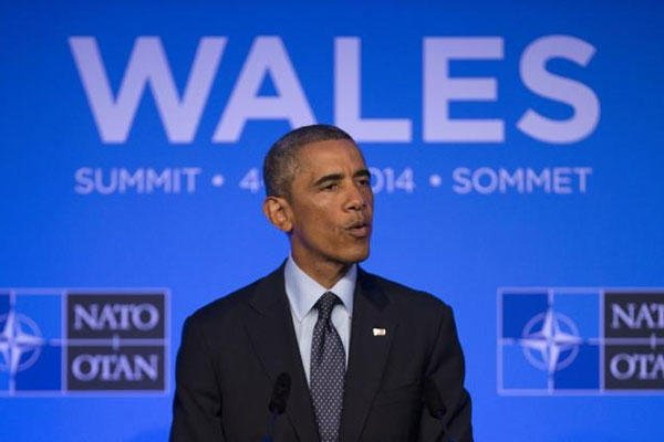 U.S. President Barack Obama speaks during a press conference at the end of the NATO summit at the Celtic Manor Resort in Newport, Wales, Friday, Sept. 5, 2014. (AP Photo/Jon Super)