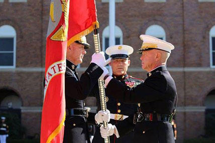 Gen. James F. Amos, the 35th Commandant of the Marine Corps, passes the colors to Gen. Joseph F. Dunford, Jr., during the change of command and subsequent retirement ceremony Oct. 17, 2014 at Marine Barracks Washington, D.C.