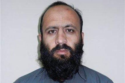 In this Wednesday, Oct. 15, 2014 photo provided by Afghanistan's National Directorate of Security, Hafiz Rashid, a senior leader of the Haqqani network, poses for a picture in Kabul, Afghanistan. (AP Photo/National Directorate of Security)