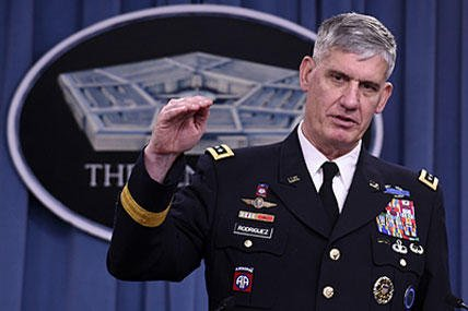 Gen. David Rodriguez, head of U.S. Africa Command, gestures during a news conference at the Pentagon, Tuesday, Oct. 7, 2014, to discuss the US military response to the Ebola crisis in West Africa. Susan Walsh/AP