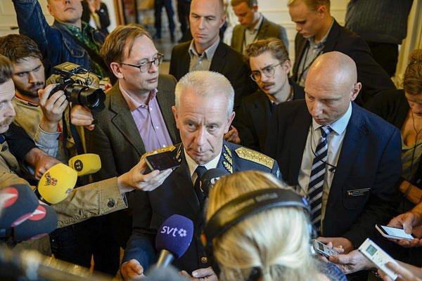Swedish Commander-in-Chief Sverker Goransson talks to media after a nearly two-hour meeting with the Swedish Parliament defence committee behind closed doors in Stockholm on Oct. 21, 2014. AP Photo/TT News Agency, Pontus Lundahl
