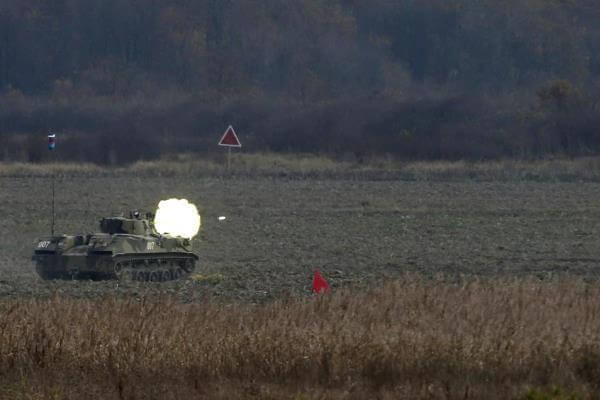 During a military exercise a Russian airborne infantry fighting vehicle BMD-2 shoots after parachuting during a Russian-Serbian joint antiterrorist exercise west of Belgrade, Serbia. Associated Press