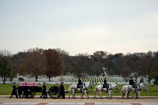 Members of the U.S. Army 1st Battallion 3rd Infantry, Caisson Platoon, carry the remains of Army Air Forces Sgt. Charles A. Gardner Dec. 4, 2014, in Arlington National Cemetery. (U.S. Air Force photo /Master Sgt. Jeffrey Allen)