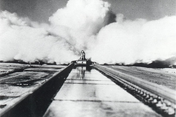 "On December 10, 1954, Col. John P. Stapp propelled down the Holloman High Speed Test Track aboard the Sonic Wind Rocket Sled 1 at a rate of 632 miles per hour, earning the title ""The Fastest Man on Earth."" (Courtesy Photo)"