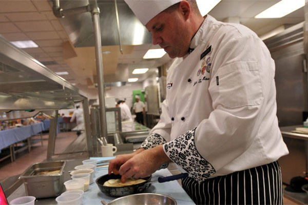 Army Sgt. Andrew Shurden prepares a potato dish during tryouts for the culinary arts team at Joint Base Lewis-McChord, Wash., Nov. 21, 2014. (Army photo by Sgt. James J. Bunn)