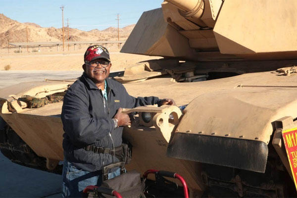 Kenny R. White, Marine veteran, native of San Diego, Calif., hugs a tank on the 1st Tank Battalion ramp, Dec. 22, 2014. Photo By: Lance Cpl. Medina Ayala-Lo