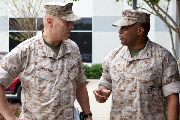 The Assistant Commandant of the Marine Corps, Gen. John M. Paxton, Jr. speaks with Commander of Marine Forces Cyber Command, Maj. Gen. Vincent R. Stewart, while on a visit with MARFORCYBER, May 15, 2014. (U.S. Marine Corps photo by Cpl. Tia Dufour)
