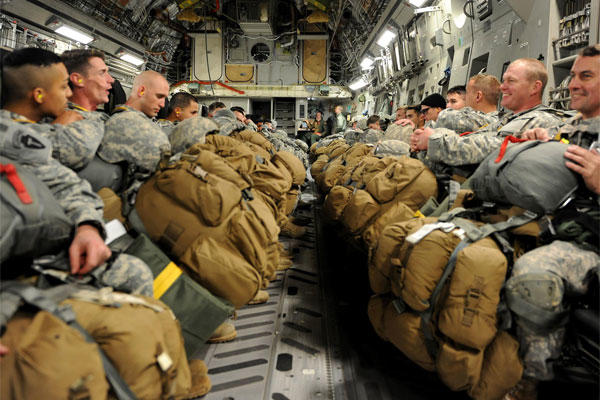 Army National Guard Soldiers wait in the cargo hold of a C-17 Globemaster III cargo aircraft before taking off for a training jump Jan. 23, 2015, in Austin, Texas. (U.S. Air Force photo/Airman 1st Class Nathan Clark)