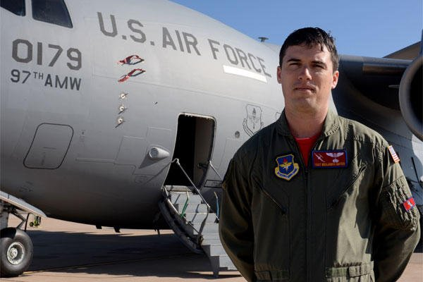 Air Force Tech. Sgt. Benjamin Gates, 58th Airlift Squadron operations flight chief, stands in front of a U.S. Air Force C-17 Globemaster III cargo aircraft Feb. 6, 2015. Courtesy photo