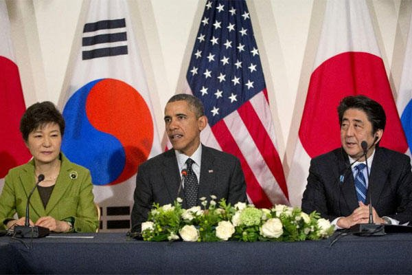 In this March 25, 2014 file photo, U.S. President Barack Obama meets with Japanese Prime Minister Shinzo Abe, right, and South Korean President Park Geun-hye at the U.S. Ambassador's Residence in the Hague, Netherlands. (AP Photo/Pablo Martinez Monsivais)