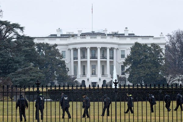 In this Jan. 26, 2015 file photo, Secret Service officers search the south grounds of the White House in Washington after an unmanned aerial drone was found on the White House grounds during the middle of the night. (AP Photo/Susan Walsh, File)
