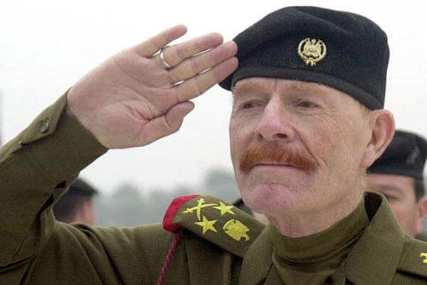 In this Sunday, Dec. 1, 2002 photo, Iraqi Vice chairman of the Revolutionary Command Council, Izzat Ibrahim al-Douri salutes during a ceremony at the Martyrs Monument in Baghdad, Iraq. (AP Photo/Jassim Mohammed, File)