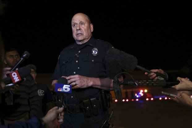 Garland Police spokesperson Joe Harn addresses media about the shooting at the Curtis Culwell Center, where a provocative contest for cartoon depictions of the Prophet Muhammad was held Sunday, May 3, 2015, in Garland, Texas. LM Otero/AP