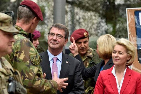US Secretary of Defense Ash Carter  and German minster of defense Ursula von der Leyen visit NATO Response Force soldiers of the I. German-Dutch Brigade in Muenster, Germany, Monday, June 22, 2015. (AP Photo/Martin Meissner)