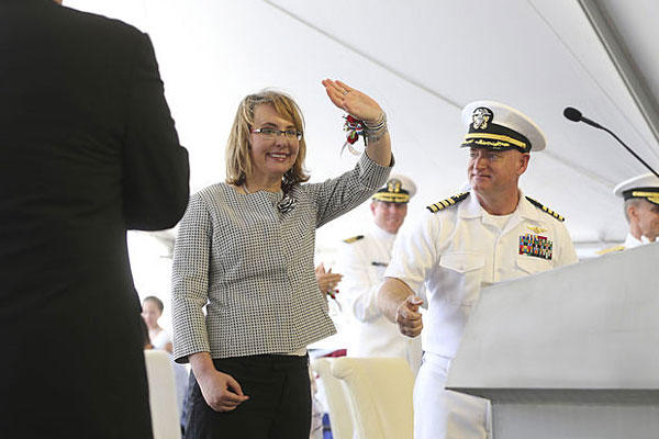 Former U.S. Rep. Gabrielle Giffords of Arizona and husband retired U.S. Navy Captain Mark Kelly greet the crowd during a ceremony, Saturday, June 13, 2015, in Mobile, Ala. Mike Brantley/AL.com via AP