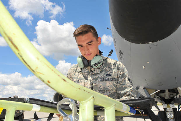 Airman 1st Class Jonah Myers, 92nd Aircraft Maintenance Squadron crew chief, reads a maintenance checklist, May 27, 2015, at Fairchild Air Force Base, Wash. (U.S. Air Force photo/Staff Sgt. Veronica Montes)