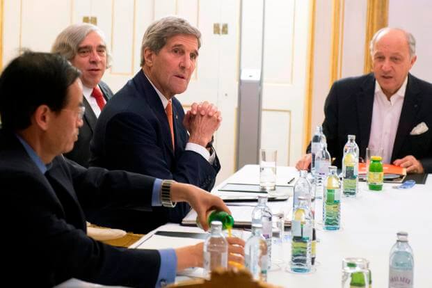 US Secretary of State John Kerry, and French Foreign Minister Laurent Fabius, right, meet at Palais Coburg Hotel, where the Iran nuclear talks are being held, in Vienna, Austria, Tuesday, July 14, 2015.(Joe Klamar/Pool Photo via AP)