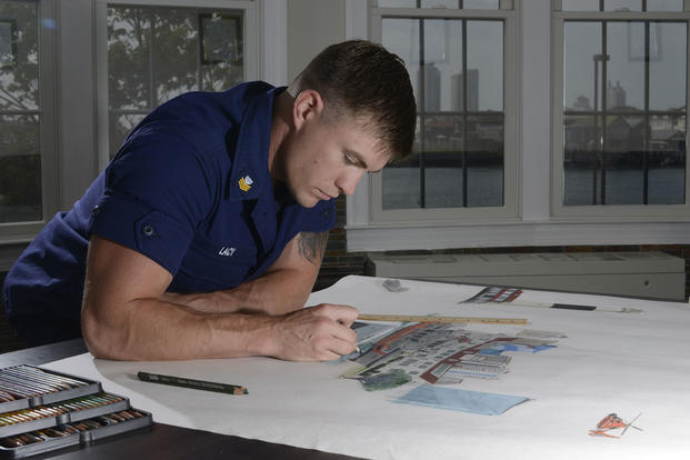Coast Guard Petty Officer 1st Class Justin Lacy, a boatswain's mate, works on chart art for Coast Guard Station Atlantic City, N.J., June 9, 2015. (U.S. Coast Guard photo/Chief Petty Officer Nick Ameen)